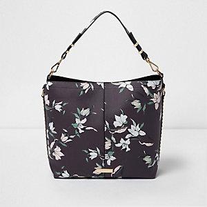 Zwarte onderarmtas met studs en bloemenprint