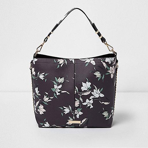 Sac souple noir clouté motif floral à porter sous le bras