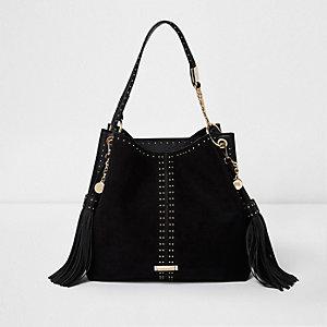 Schwarze knautschige Tasche mit Nieten und Quasten