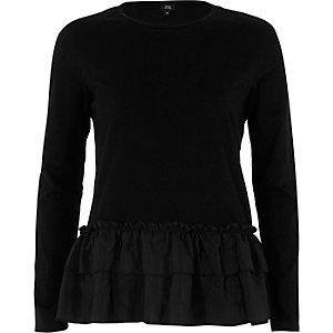 Zwart geweven T-shirt met lange mouwen en ruches aan de zoom