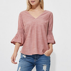 Petite rust cross back bell sleeve top