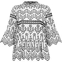 White embroidered cutaway hem smock top