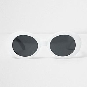 Lunettes de soleil blanches avec monture ovale et verres teintés