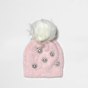 Light pink brooch faux fur bobble beanie hat