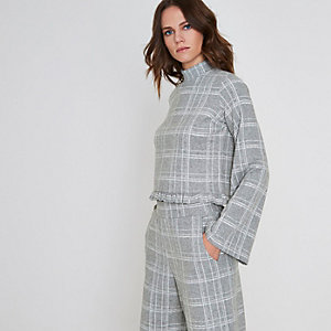 Grey check wide sleeve frill hem knit top