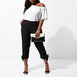 RI Plus - Zwarte smaltoelopende broek met strikjes aan de zoom