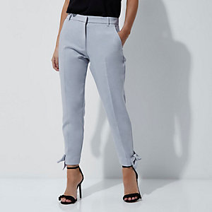 Petite light blue bow hem trousers