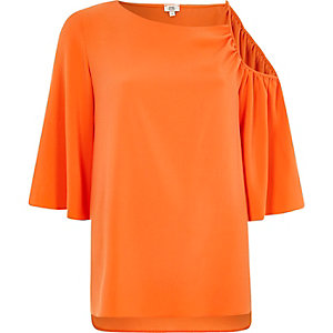 Orange asymmetric cold shoulder top