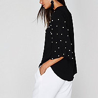 Black faux pearl high neck cape top