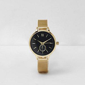 Montre dorée à bracelet effet tulle et cadran rond