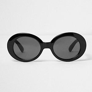 Lunettes de soleil noires avec monture ovale et verres teintés