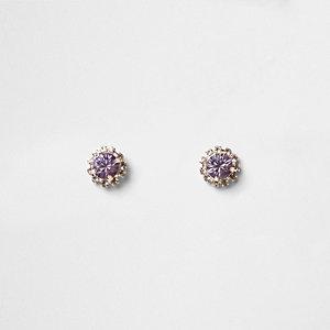 Clous d'oreilles façon or rose ornés de strass violet