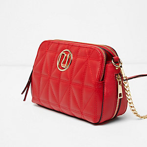 Red quilted cross body chain bag
