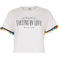Wit T-shirt met pompon en 'falling in love'-print