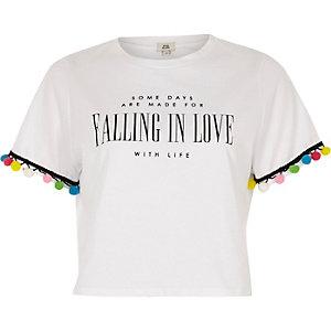 T-shirt «falling in love» blanc avec pompon