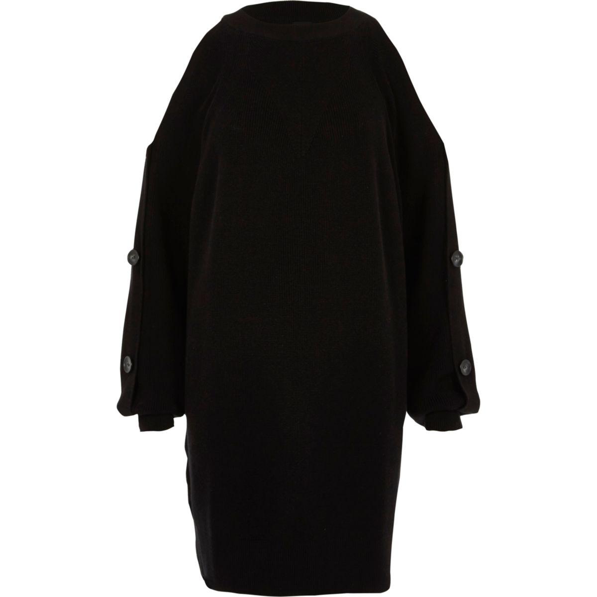 Zwarte gebreide trui-jurk met knopen op de mouwen