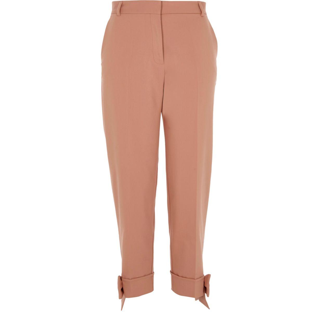 Pink bow hem cigarette trousers