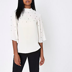 Cream faux pearl embellished cape top