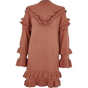 Roze gebreide jurk met ruches en rolkraag