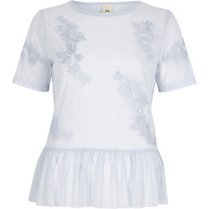 Light blue floral applique peplum mesh top