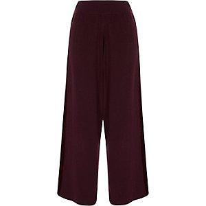 Pantalon large bordeaux avec empiècements en velours