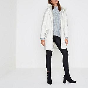 Crème lange gewatteerde jas met rand van imitatiebont