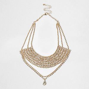 Gold tone statement drop necklace