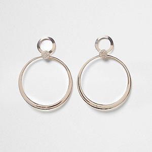Pendants d'oreilles or rose à anneau pavé