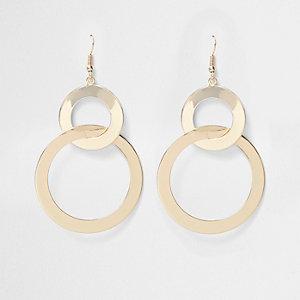 Goudkleurige oorbellen met dubbele gelinkte ring