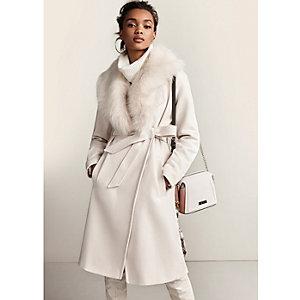 Manteau long crème ceinturé à col en fausse fourrure
