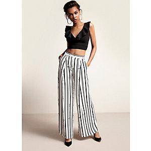 Black stripe print wide leg trousers