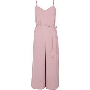 Combinaison jupe-culotte et caraco rose clair à lanières dans le dos
