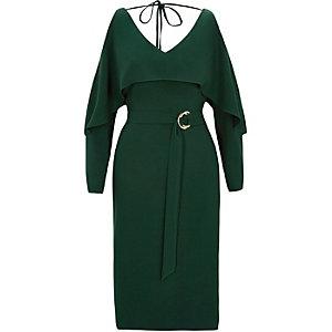 Groene schouderloze jurk met lange mouwen en ceintuur