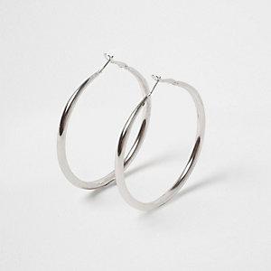 Silver tone hoop earrings