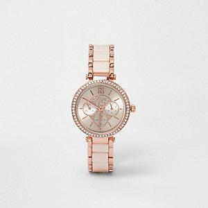 Armbanduhr in Roségold mit Strassverzierung