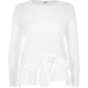 T-shirt blanc à manches longues et ourlet à volant fendu