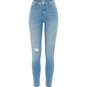 Light blue ripped released hem Molly jeggings