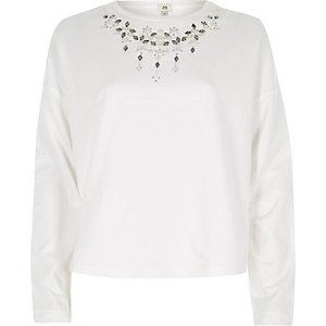 Wit cropped sweatshirt met kettingdetail