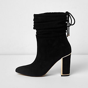Black slouch gold tone trim block heel boots