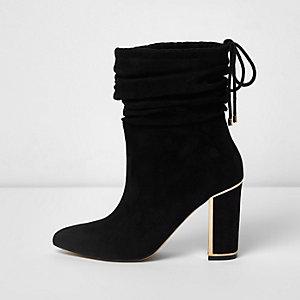 Zwarte laarzen met goudkleurig accent en blokhak
