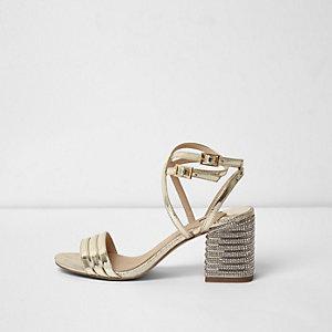 Sandales dorées métallisées à talons carrés et strass