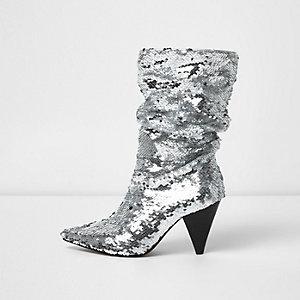 Zilverkleurige laarzen met kegelvormige hak en lovertjes