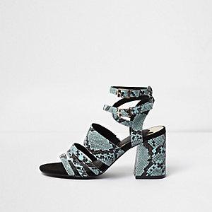 Blauwe sandalen met blokhak en slangenprint met reliëf