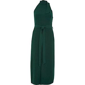 Donkergroene hoogsluitende midi-jurk met strikceintuur