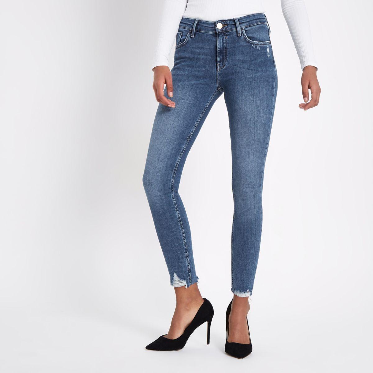 mid blue amelie ripped hem super skinny jeans skinny