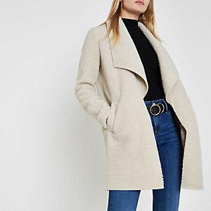Crème openvallende jas met borg