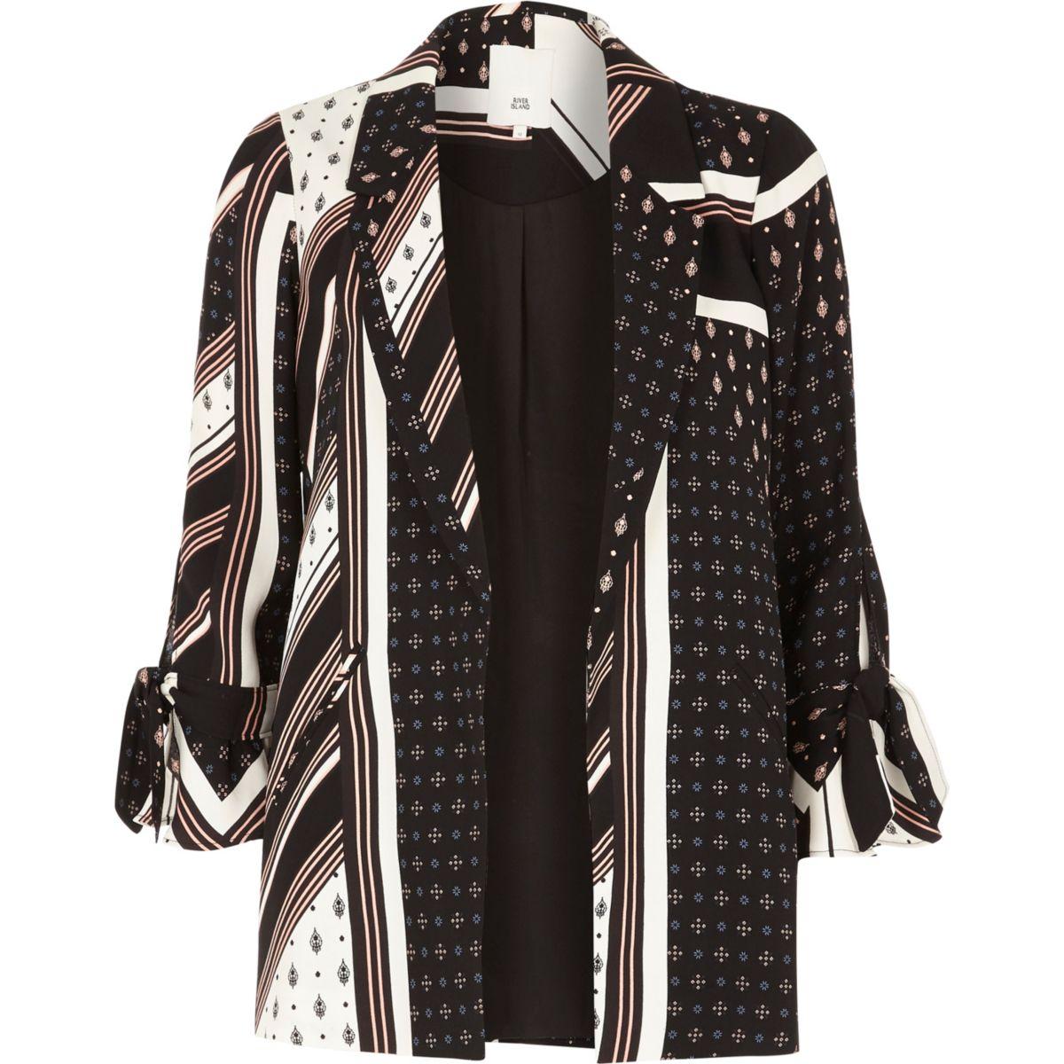 Zwarte blazer met strik aan de mouwen en verschillende prints