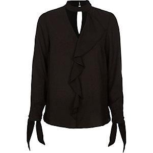 Zwarte blouse met ruches, chokerhals en strikken aan de mouwen