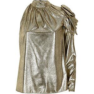 Metallic gouden top met blote schouder