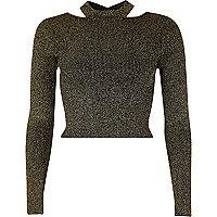 Zwart en goudkleurige lurex aansluitende crop top